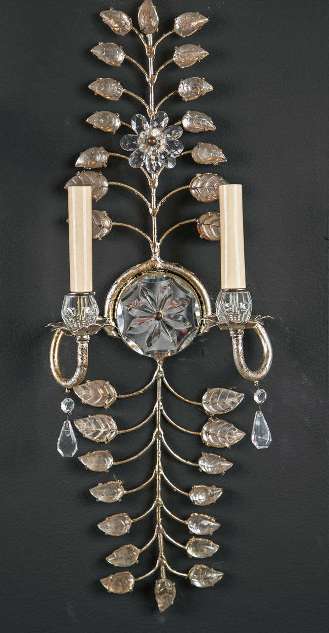 A fabulous set of six, circa 1930s French crystal sconces with silver leaf and crystal leaves.