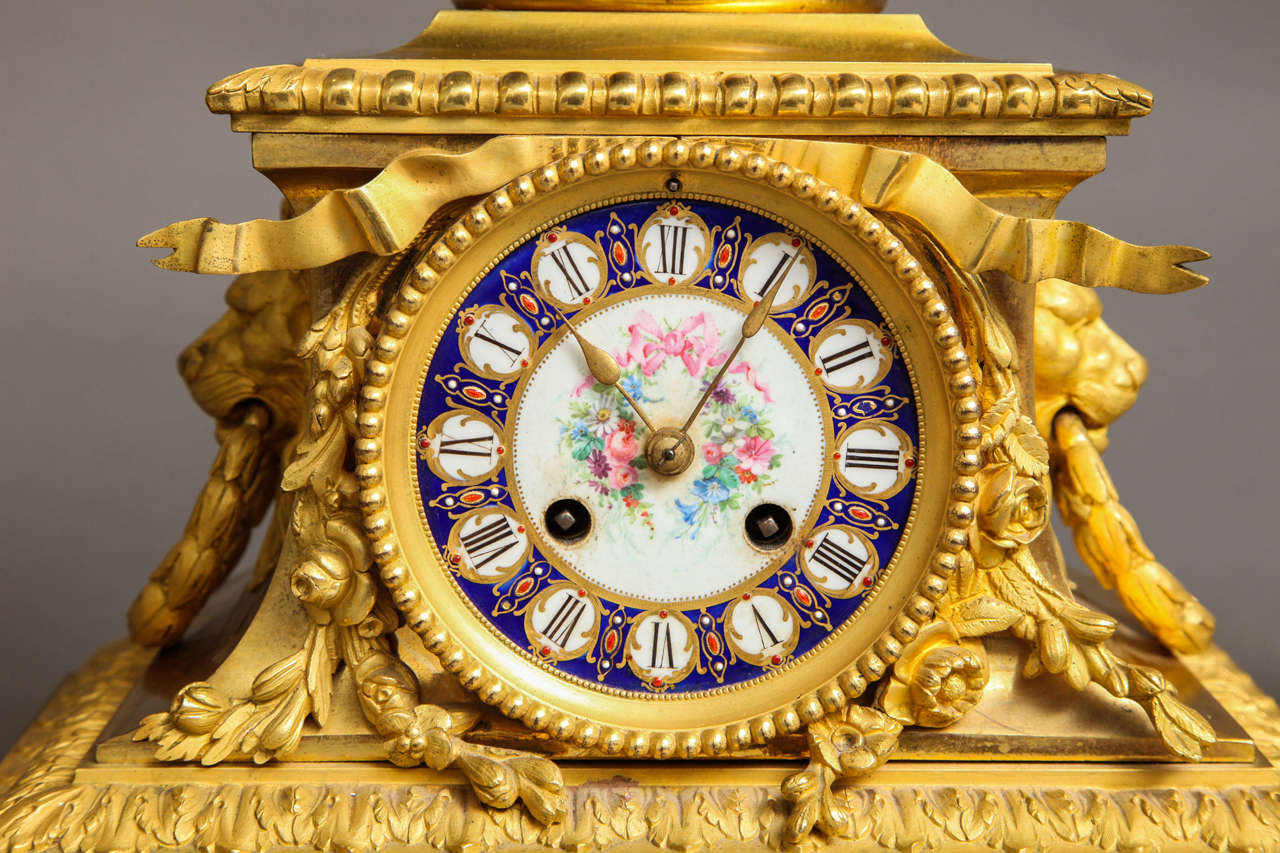 Sèvres Royal Blue Porcelain and Ormolu-Mounted Three-Piece Clock Garniture In Good Condition For Sale In New York, NY