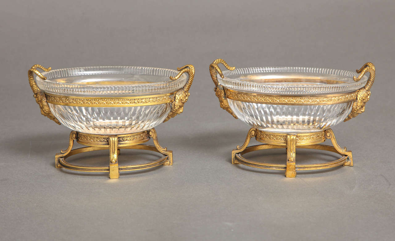 A beautiful pair of hand diamond cut Russian crystal and doré bronze mounted oval shaped centerpieces in the Louis XVI style, attributed to the Imperial Russian Glass Manufactory, early 1800s. Eachbeautiful hand diamond cut crystal bowl mounted in