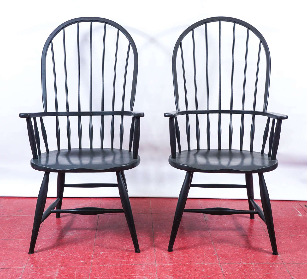 These sack back Windsor armchairs are tightly constructed with double stretchers and secured arms and backs.  Measure: Arm height: 26.75