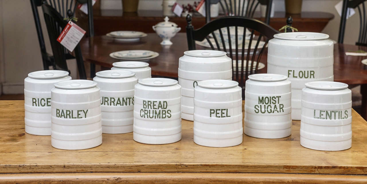 The maker is Grimwade and dates circa 1910 with original writing on each jar. All have their lids. It is rare to have all the lids and this is a complete set for someone's kitchen. The color of the writing is a pale green. This set wont last