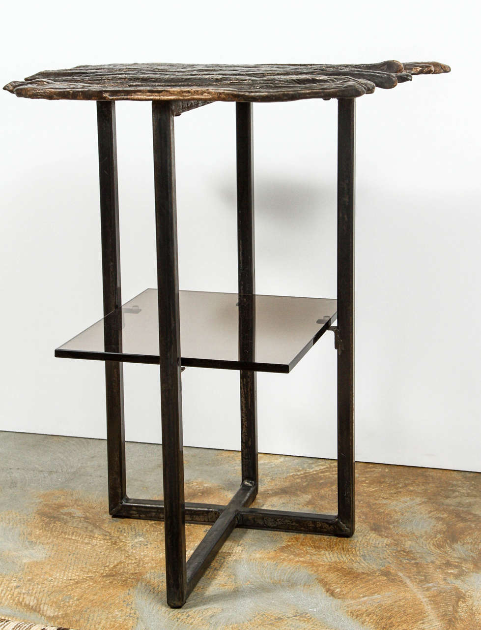 Modern, organic modern Paul Marra cast bronze Pod Table. Cast bronze and steel with bronze patina and with bronze tinted glass shelf. Two currently in stock; price is per table.