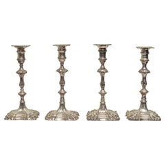 English Cast Sterling Silver Candlesticks in an Assembled Set of Four