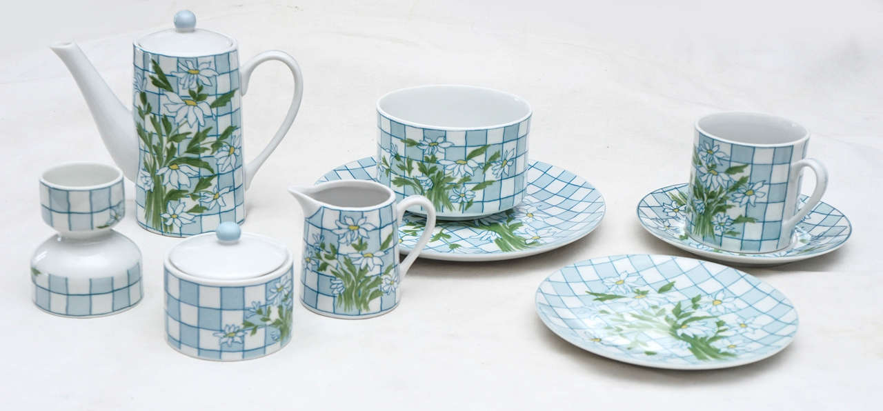 Charming 11-piece porcelain breakfast set. Includes coffee pot with top, cream and sugar with top, cereal bowl, egg cup, two plates, one 8