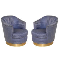 Pair of Barrel Back Swivel Club Chair by Karl Springer