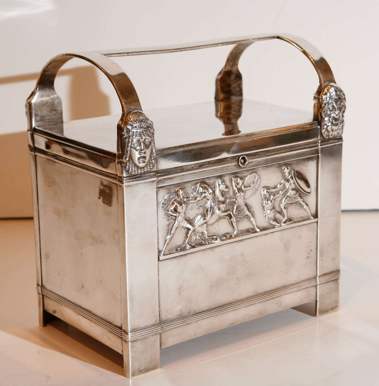 Silver plated, art-deco humidor featuring reproductions of the famous Bassae Frieze which depicts a battle between the Trojans and the Amazons.