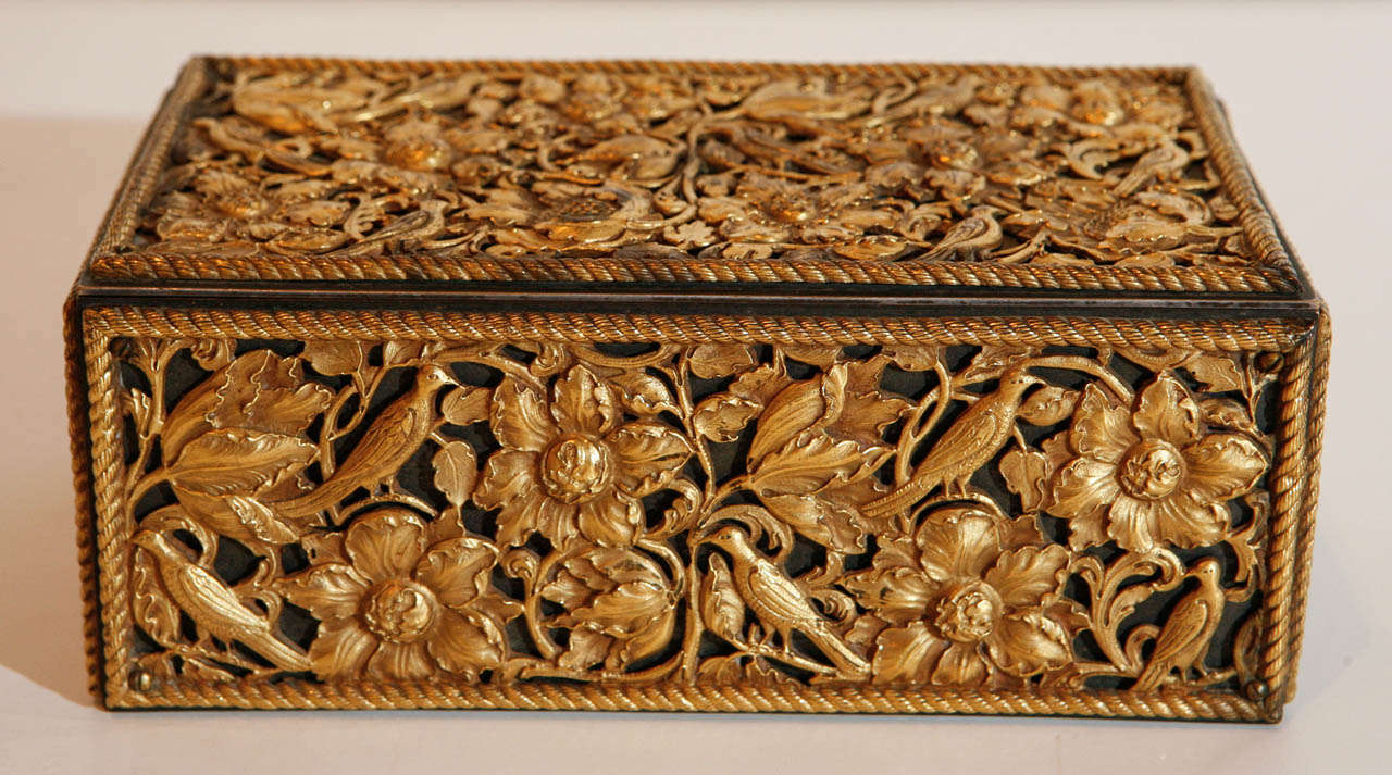 Steel and gilt bronze humidor by premier, New York manufacturer, E.F. Caldwell & Co.