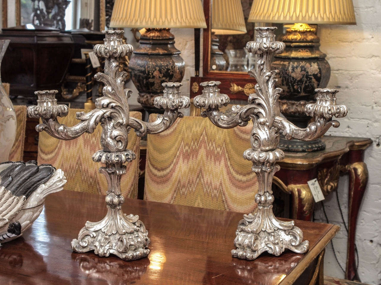 Pair of Italian Louis XV style 19th c. Silver Gilt carved wood three arm candle sticks.