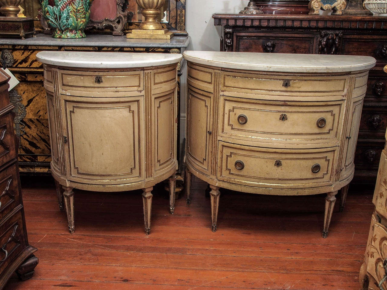 Beau Suite Of Two Italian Luigi XVI Painted And Parcel Gilt Demi Lune Cabinets ,  One With