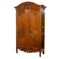 French 1740s Period Louis XV Walnut Armoire with Ribbon-Tied Floral Medallion