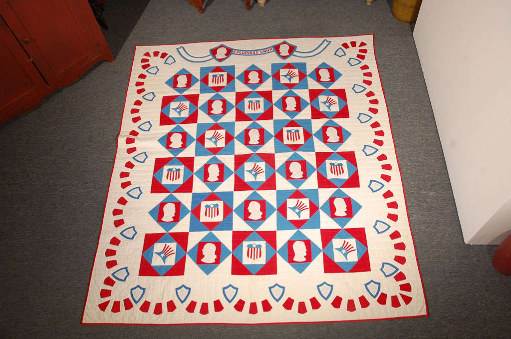 This is such a fine example of Americana at its best. This fantastic applique quilt has the profile of George Washington and Abe Lincoln along with the Uncle Sam hat and the Patriotic shield in every other block. The wonderful swag border also has
