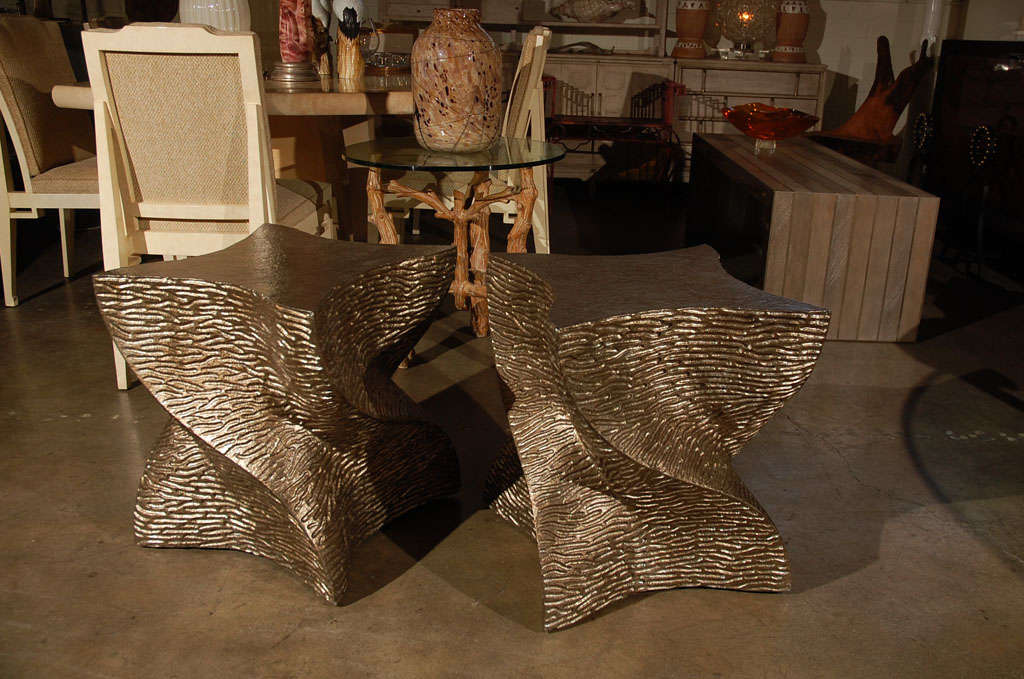 Modern, organic modern, contemporary Paul Marra twist side table finished in a textured bronze-gold. Inquire for availability. Price is per table. Excellent with natural variation in wood. See all photos, as color and texture will vary from table to