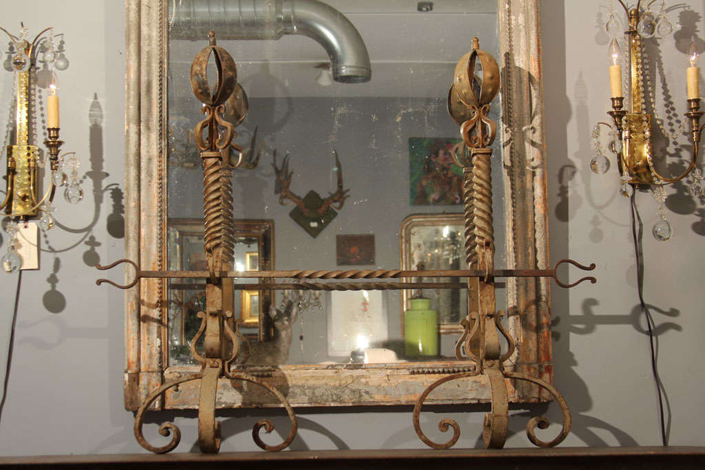 Large pair of andirons with cross bar.