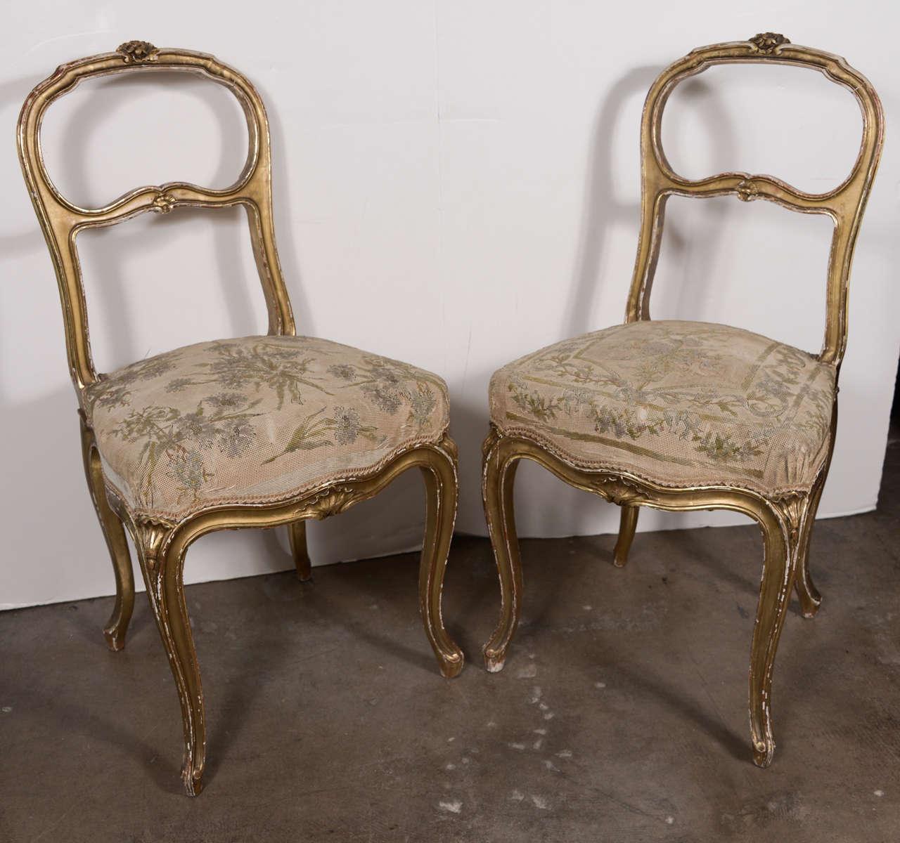 Pair of 18th century gilt ladies' chairs.