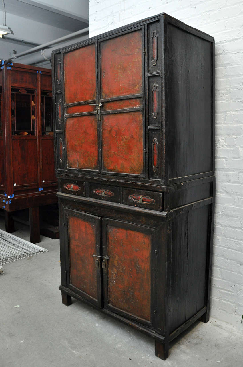 18th century painted Chinese black lacquer two-piece cabinet This cabinet is a wonderful tailored design with the opportunity to separate the pieces and use as two cabinets Condition of lacquer is poor and could use restoration The structure is