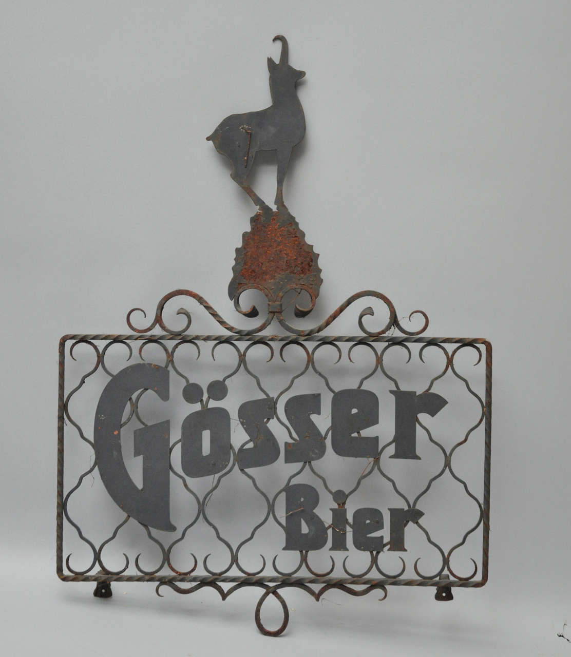 Austrian wrought iron Gösser beer sign from the turn of the 20th century. Rectangular shaped frame with Gösser Bier logo amidst scrolled background, surmounted by a graceful stylized stag ornament. Gösser Bier is not only one of the best brands of