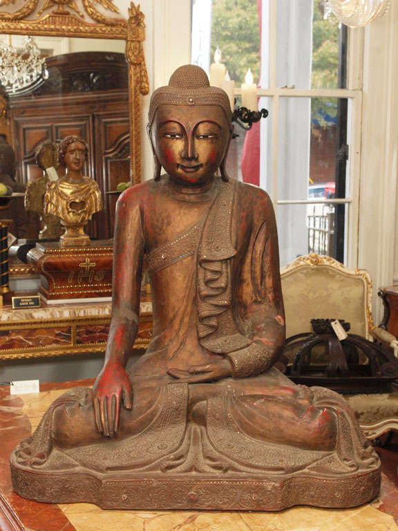 Exceptionally Large Thai Buddah with original gilt finish and red bole coming through. Has small metal stud decoration around fabric edges.
