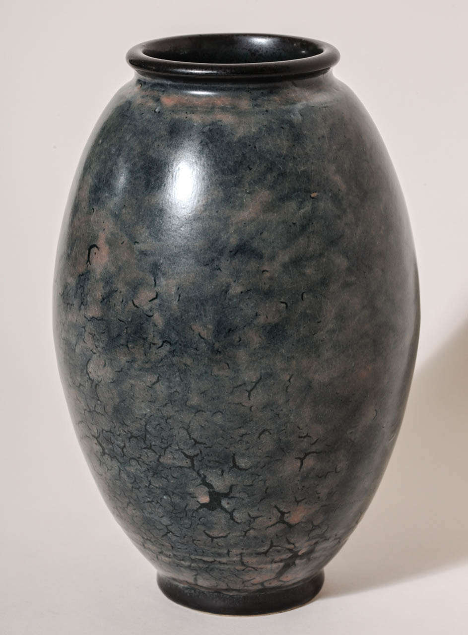 This mottled blue vase has gray undertones, multiple rings around the base and a black enameled rim and foot. Signed: EDecoeur incised   *Other Emile Decoeur vases available.