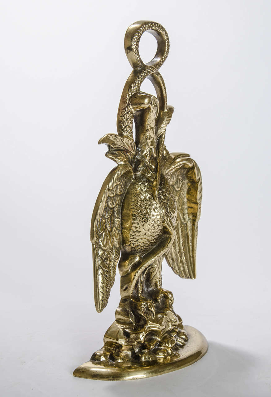 A splendid door stop in the form of an eagle perched on rocks, English Regency, circa 1820.