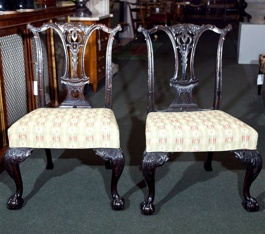 A set of six English mahogany, Chippendale-style side chairs.