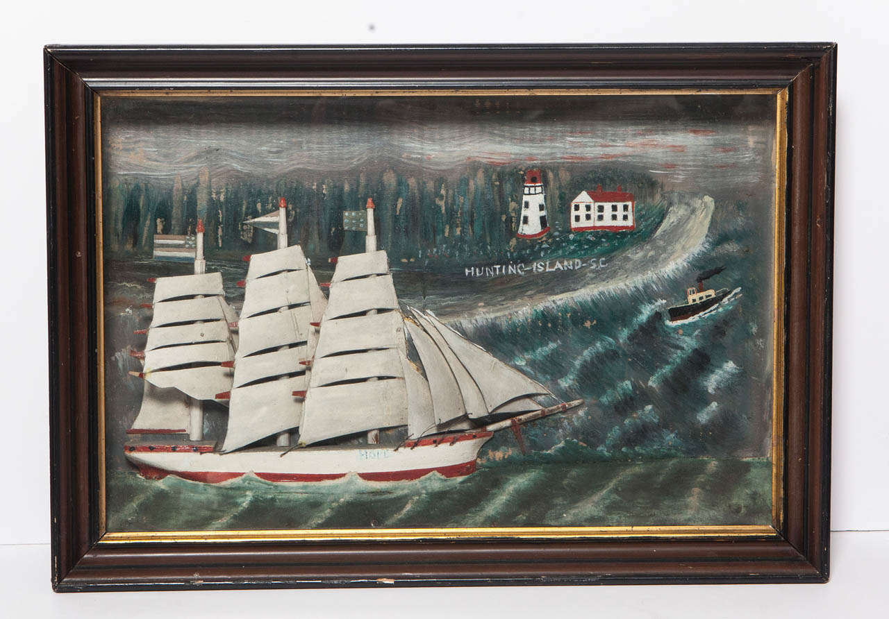 Diorama with sailboat named Hope sailing through waters in Hunting Island, SC; lighthouse and steamboat in the distance. Wood shadow box.