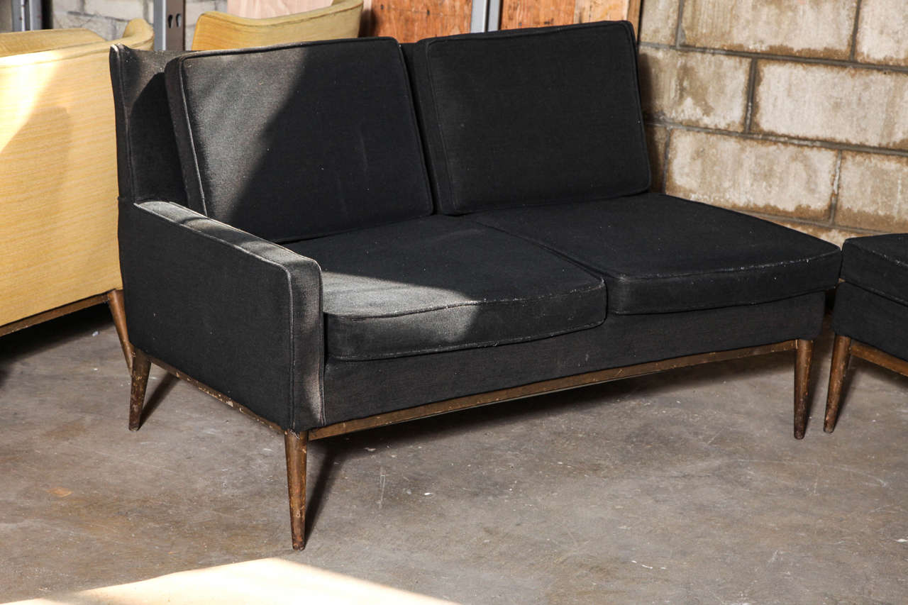Rarely-seen sectional version of the model 1307 sofa. Handsome two-piece sofa with sleek, tapered legs designed by Paul McCobb for Directional. Measurements are 50.5 W x 32 D x 30 H