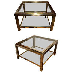 A pair of  metal two-tiers end tables