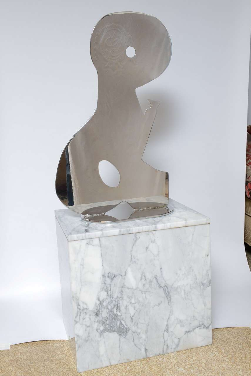 Abstract polished metal sculpture on by American artist Jack Schuyler.   Signed and dated (1997). Sculpture measures 30.5 in. high x 19 in. length x 9 in. deep.   The sculpture can be purchased separately from the base and the base separate from