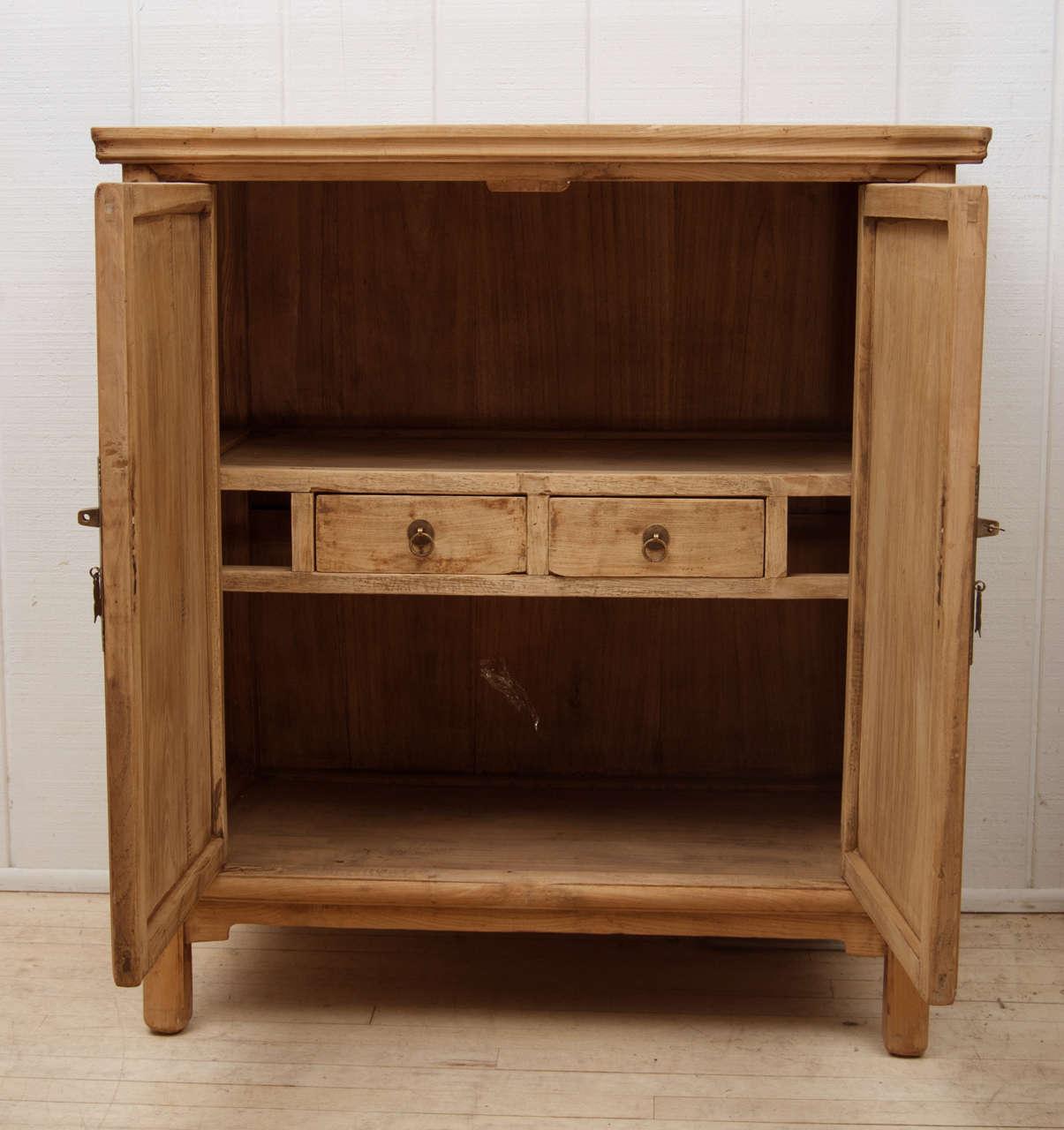 Natural wood cabinet at stdibs