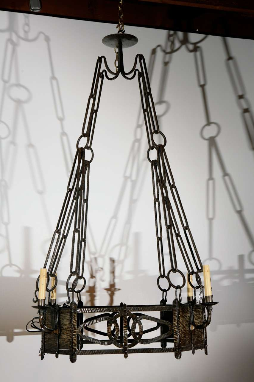 Finely hammered brass chandelier with four lights.
