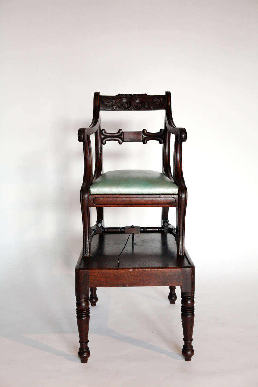 Period English Regency mahogany high chair with a table form base and detachable chair with 20th century leather seat.