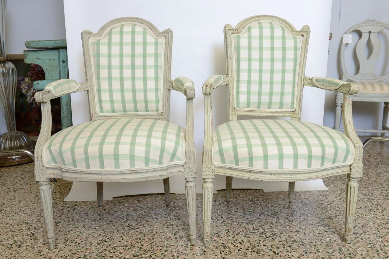 Antique pair of beautifully carved Swedish armchairs. Unknown Stockholm maker. Refreshed with layers of original paint; reupholstered.