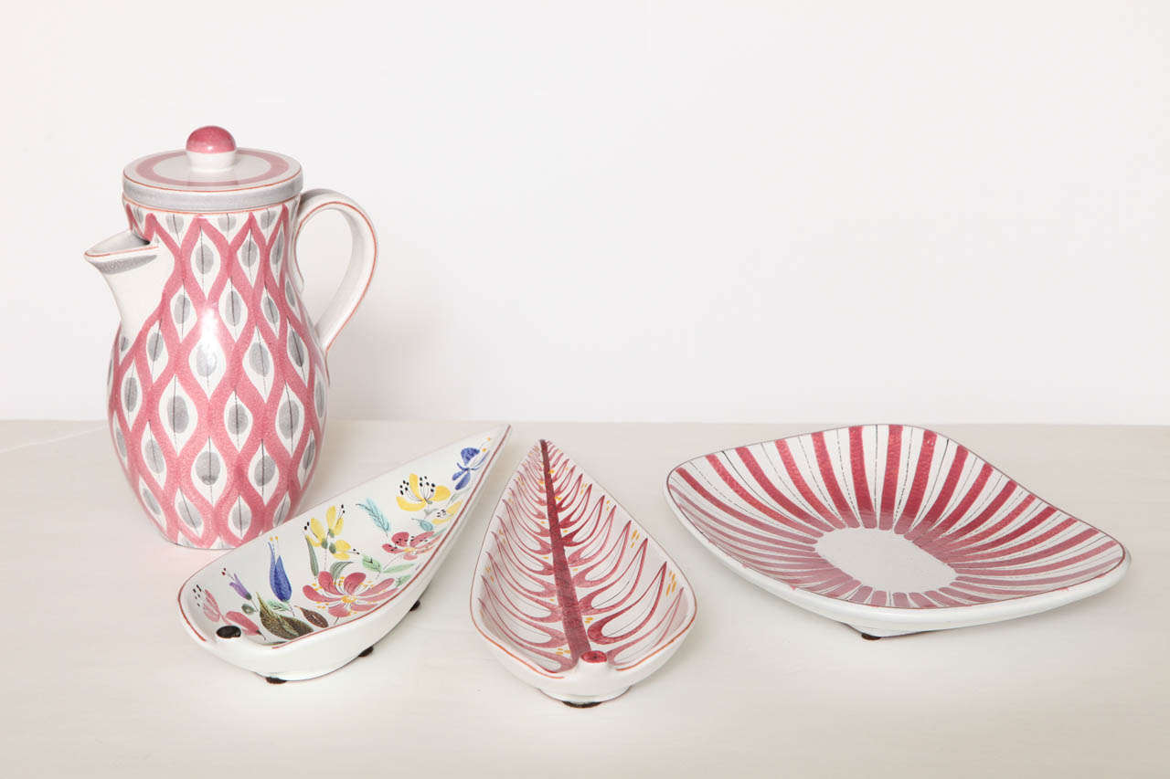A beautiful group by Stig Lindberg, Sweden, circa 1950. Pitcher is diameter 4.5 inches, H 9 inches, $1450 . Two leaf bowls, each L 12.75 inches, W 4.5 inches, H 1.75 inches, $950. Plate L 10 inches, W 7.5 inches, H 1.5 inches $950.