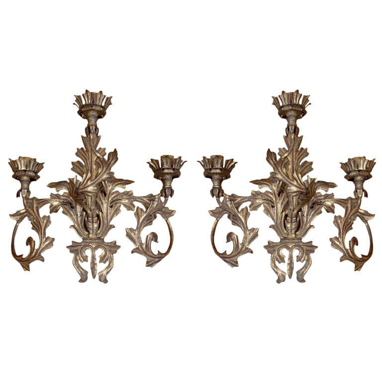 Decorative and charming pair of three light sconces in a gilt metal, Italian, Baroque style, can be re-electrified to US code