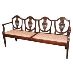 Antique Italian walnut settee.