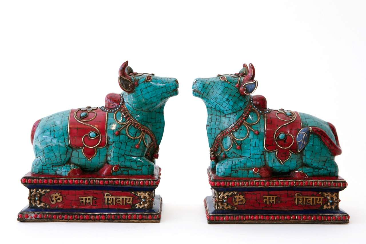 Pair Of Sacred Bull Sculptures Inlaid With Coral