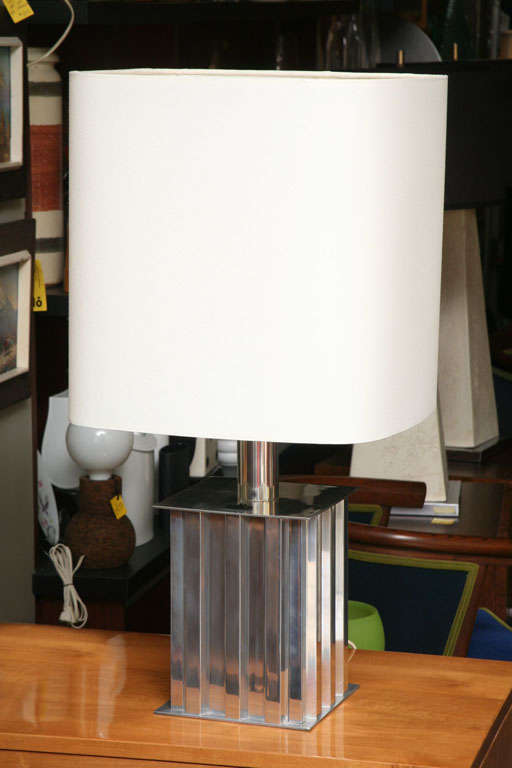 REDUCED FROM $885. With a polished aluminum geometric form, this table lamp from Brazil has strong machine age influences and a very modern profile, shaped shade and great presence. Unique built in shade attachment design and an on/off switch on the