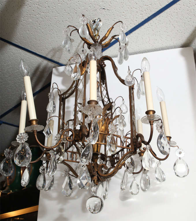 A Fine Cage Form Eight Light Crystal And Bronze Chandelier Stock Number L409