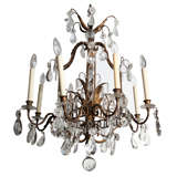 A Fine Cage Form Eight-Light Crystal and Bronze Chandelier