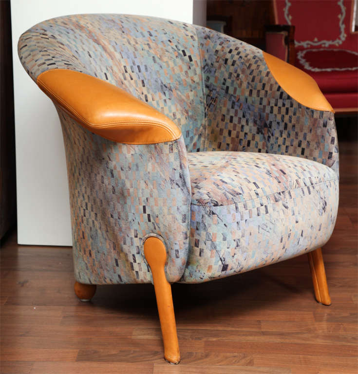 Pair of Postmodern bergères by Franz Wittman, Austrian, circa 1975 upholstered with velvet-textured Missoni fabric, with brown leather legs and armrests.