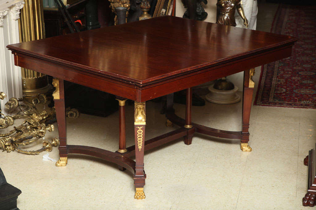 Very fine quality French gilt bronze-mounted mahogany dining room table. Stock number: F7.
