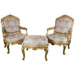 Pair of French Bergere Chairs and Ottoman in Gilded Wood and Satin Upholstery