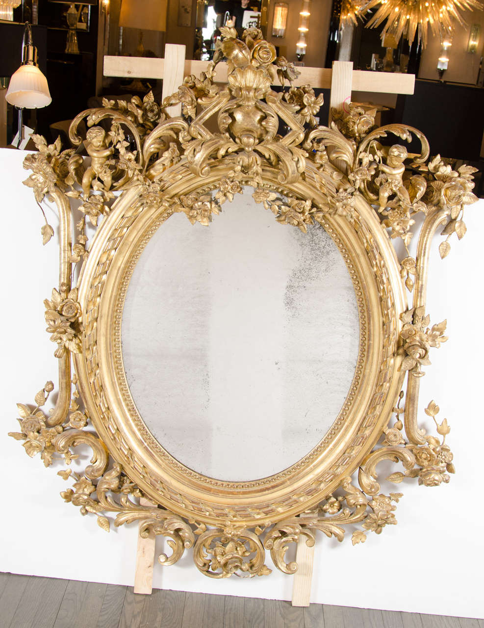 Magnificent 19th Century French Rococo Oval Mirror With 24k Gold Gilt Details And Stylized Foliage Detailing