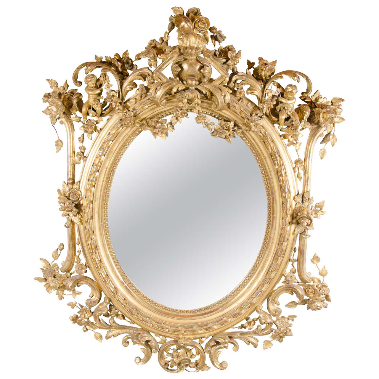 French Rococo Oval Mirror With 24 Karat Gold Gilt And Foliage Details For