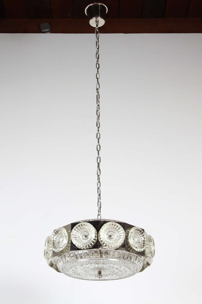 Chrome and glass fixture by Orrefors of Sweden. Newly rewired for four candelabra bulbs.