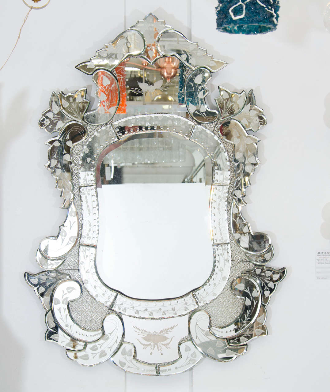 A Vintage Ornately Carved Etched Venetian Wall Mirror With Leaf Motif Hammered Silver Detailing