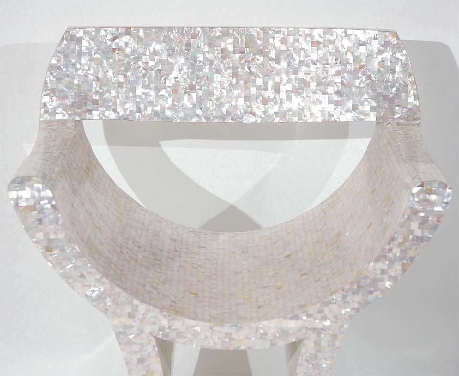 This beautiful hand crafted tessellated mother of pearl veneered armchair with great artistic flair is a real stunner.