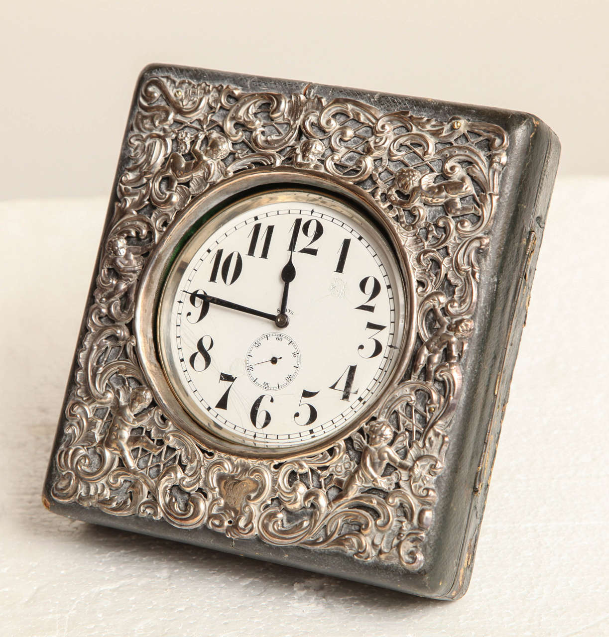 Late 19th Century Swiss Traveling Clock Made for the English Market Enclosed in a Silver and Leather Case