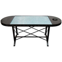 A Mid Century Iron Table with Blue Glass Top