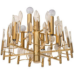 A Mid Century Brass and Glass Chandelier